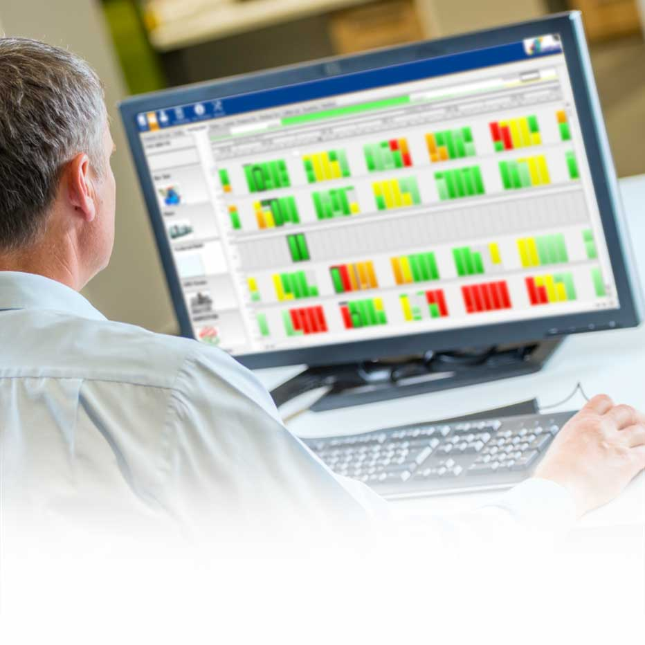 man at a print packaging facility using software